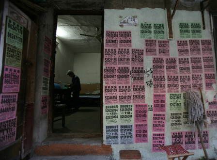 The last days of old Nanjing-flyers advertising moving services pasted on the wall of a home for senior citizens. Photo: Economic Observer